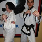Sarah Stienbacher, left, took first place in sparring and Javon Lopez, right,  took first in black belt weapons division in a Cheezic Tang Soo Do tournament held on January 23rd at the Boys Club in Waterbury.  Stienbacher and Lopez train at USA Martial Arts in Naugatuck.
