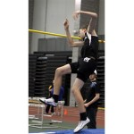Woodland's Brett Fowler vaults over the pole at the NVL Indoor Track Championships, in New Haven Feb. 9.