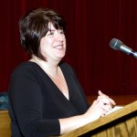 Board of Education candidate Debra Brackett introduces herself at a forum Monday night at City Hill Middle School.