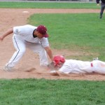 Naugatuck third baseman Rich Pimental puts the tag on a Derby runner trying to get back to the bag on Saturday for one of three inning-ending double plays pulled off by the Greyhounds.  PHOTO BY KEN MORSE
