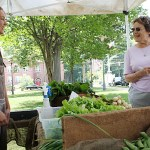 Beverly Krayeski talks with Victoria Boecklin of George Hall Farm Wednesday at the Naugatuck farmer's market's opening day. The market will be open along Church Street on the Town Green Wednesdays from 10 a.m. to 2 p.m. and Sundays from 9 a.m. to 1 p.m. through October 26. LARAINE WESCHLER