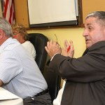 Labor attorney Francis D'Urso addresses the crowd Monday night during a public hearing a proposed ordinance changes that would eliminate the elected positions of tax collector and town clerk. D'Urso helped to draft the proposal. LARAINE WESCHLER