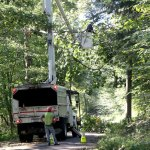 A CL&P crew works to clear fallen trees and branches to restore power August 2011 in Prospect. The company is seeking to collect $414 million in costs from ratepayers associated with damage caused by five major storms that hit in 2011 and 2012. –FILE PHOTO