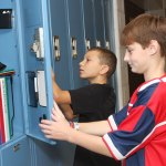 Senol Music, 11, right, and Nick McCusker, 11, check out their lockers during an Aug. 18 orientation for incoming Long River Middle School sixth-graders. The first day of school for Region 16 and Naugatuck is next week. - LARAINE WESCHLER