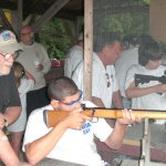 NRA rifle instructor Tim Curran guides Brandon Burgos of Naugatuck during a First Shots program held July 30 at the High Rock Shooting Association of Naugatuck. CONTRIBUTED