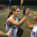 Naugatuck's Shannon Hale is congratulated by her teammates after hitting a solo homerun in the Joan Joyce softball league championship game Aug. 3. RA ARCHIVE