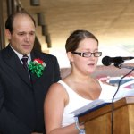 Andreia Conceicao reads a statement from her father, Carlos Conceicao, standing behind her, accepting his nomination as Portuguese mayor of the day Sept. 2. -LARAINE WESCHLER
