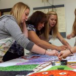Long River Middle School student McKayla DeBrizzi, teacher Cathy Barone, and students Lisa Thrasher and Heather Bernier work on the mural Oct. 6.  - LARAINE WESCHLER