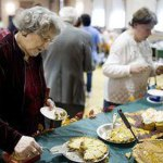 Loretta Rinaldi, left, from Waterbury, gets a slice of pie at St. Michael's third annual Thanksgiving dinner in Naugatuck on Nov. 22, 2007. RA ARCHIVE