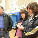 From left, Selectman Chris Bielik, and Board of Education members Wendy Oliveira and Sheryl Feducia listen to the Beacon Falls results for the Region 16 school referendum Tuesday night at Laurel Ledge School. The referendum failed in Beacon Falls, but passed overall due to support in Prospect.