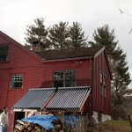 Beacon Falls resident Bill Giglio recently installed solar panels and a wind turbine at his home on Bethany Road to take advantage of renewable energy. -LARAINE WESCHLER