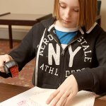 Jessica Przybylski, 12 creates Valentine's Day cards at the Prospect Public Library Feb. 10.