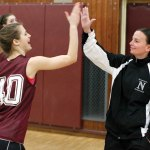 Naugatuck girls basketball head coach, Jodie Ruccio, right, high-fives Emma Colucci during a practice drill Friday afternoon at Naugatuck High School. –RA ARCHIVE