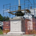 Scaffolding encircles the World War I monument in downtown Naugatuck last August. Events, such as Hurricane Irene and the October nor'easter, have caused delays in the restoration effort. But, after a several month hiatus, restoration work on the monument is expected to begin again within weeks. –FILE PHOTO