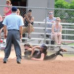Naugatuck's Gretchen Hale slides safely into third Tuesday afternoon in the opening round of the Class L tournament against New Canaan in Naugatuck. –LUKE MARSHALL