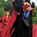 Naugatuck High School graduate Michael Jackman gives Principal Janice Saam a big hug after receiving his diploma Tuesday night. –LUKE MARSHALL