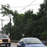 A tree rests on the power lines at the intersection of New Haven Road and High Street in Naugatuck. –LUKE MARSHALL
