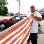 Mike Lanese, manager of Jim Juliani Motors in Prospect, talks about the American flag banner he was told to take down at his business on Waterbury Road in Prospect. The town of Prospect says he is only allowed one detached commercial sign and the vertical banner flag signs are not American flags. –RA ARCHIVE