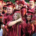 Members of Naugatuck High School's Class of 2012 turn their tassels during graduation ceremonies at the school in June. Next year, graduation ceremonies will be held at the Palace Theater in Waterbury as the school undergoes renovations. –FILE PHOTO