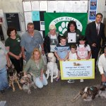 Members of the Trap Falls Kennel Club pose with Naugatuck Mayor Robert Mezzo Aug. 10 in Naugatuck Town Hall following a ceremony declaring Saturday Dog-A-Tuck Day in the borough. –FILE PHOTO