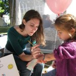 Allyson Leighton, of Cheshire, gets her arm painted by Kiersten Radke during the 2010 Harvest Moon Festival on the Naugatuck Town Green. This year's festival, which features dozens of vendors, will be held Friday and Saturday. –RA ARCHIVE
