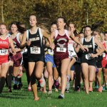 Woodland's Mary Sardinskas (146) and Naugatuck's Jordyn Allen (46) look to separate themselves from the pack at the start of the NVL cross country championships Tuesday afternoon in Watertown. Allen was the Greyhounds' top finisher and finished fifth overall in 20:40. Sardinskas led the way for the Hawks. She came in third overall in 20:16. –LUKE MARSHALL