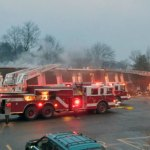 Firefighters from the borough and Waterbury battle a fire Friday on the roof of Building 8 of Southwood Apartments on Rubber Avenue in Naugatuck. –RA ARCHIVE