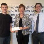 The Woodland Interact Club raised $1,073.60 for the South Asia Pure Water Initiative last spring and presented the check in December. Pictured, from left, Seth Stevens, former president of the Interact Club, Cathy Forsberg, treasurer of the South Asia Pure Water Initiative, and Paul Geary, co-advisor of the Interact Club. –CONTRIBUTED
