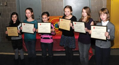 The Naugatuck Fire Department recently held its 7th annual Connecticut Fire Prevention Poster Contest for borough students. On Jan. 23, the department recognized the contest winners, from left, fourth-graders Makayla Cristanti, Livia Sarnelli, Rebecca Carney, fifth-graders Hailey Russell, Kylie Neretich and Izabella Kozlowski. The winners received bicycles and helmets paid for through a $1,000 grant from the Walmart Foundation. The posters made by first place winners Cristanti and Russell will move on to the New Haven County competition. –LUKE MARSHALL
