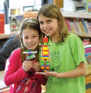 Sara Alessio, 8, from Beacon Falls, left, and Taylor Wasilewski, 10, from Beacon Falls show off the robots they made during the Beacon Falls Public Library's Legos in the Library program Feb. 13. –LUKE MARSHALL