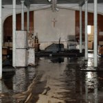 Over 5 feet of water flooded the basement of St. Francis of Assisi Church in Naugatuck in August leaving the basement muddy and destroyed. –FILE PHOTO