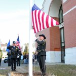 Lt. Brian Newman, right, of the Naugatuck Police Department raises the American flag to half mast as Sgt. Randy Ireland salutes Sunday morning in front of the department on Spring Street during a memorial service to honor Officer Nancy Nichols. Nichols was killed 22 years ago in the line of duty. –ELIO GUGLIOTTI