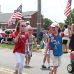 Girls Scouts from Prospect Troop 54639 show off their patriotism during Prospect's 2012 Memorial Day parade. –FILE PHOTO
