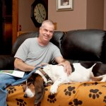 Jeff Saguta of Naugatuck spent years fighting for a kidney and pancreas transplant and now he finally has new organs and he is no longer diabetic. Saguta talks about his progress at his home last week next to his dog George. –RA ARCHIVE