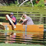 Joe Rodorigo, right, and Domenick Sorrentino paddle their cardboard boat last July on Carrington Pond at Matthies Park during Beacon Falls' first Cardboard Boat Regatta.  -FILE PHOTO