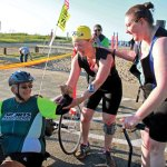 Tayna Sage of Prospect, center, Tony Allegretti, left, and volunteer guide Kathie Wynkoop take part in the Dave Parcell's Madison Triathlon on Sept. 7.  -KATIE JOLY