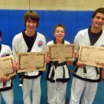 Four members of USA Martial Arts in Naugatuck were promoted at a Cheezic Tang Soo Do Karate black belt graduation Nov. 22 at the Boys Club in Waterbury. Pictured, Sean Evardo was promoted to 1st Dan Black, Eric Wrogg and Ben Meleschnig were promoted to 2nd Dan Black and Matthew Hopkinson was promoted to 3rd Dan Black. -CONTRIBUTED