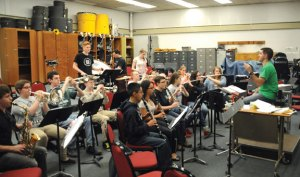 Naugatuck High School band director Robert Hughes, right, warms up the band April 10 at the school. Members of the band left for a week-long trip to France April 11. The trip is part of a cultural exchange program. –LUKE MARSHALL