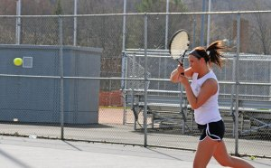 Woodland's Hope Gavigan returns a shot versus Naugatuck's Hannah Kim April 17 in a match of No. 1 singles in Naugatuck. Kim won the individual match by an 8-1 margin, but the Hawks won the team match, 4-3. –LUKE MARSHALL