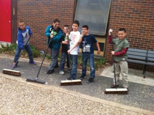 Rhya Szymansky, lead teacher on the Parent Engagement Committee, and her team organized an Earth Day celebration for students and parents at Andrew Avenue School in Naugatuck April 22. Each grade level was designated an area around the school to clean up. Students also used the school's outdoor classroom to plant seeds, which were put into the greenhouse. The plants will eventually be planted in the school's plant beds in late May. Naugatuck Recycling and Solid Waste Coordinator Sheila Baummer taught students about what, how and why we recycle. Mayor Robert Mezzo also visited the school and read stories to students about what they can do to help out. The day concluded with students decorating paper hands, which they wrote their name on and hung on trees to symbolize a pledge to keep the Earth a beautiful place to live. -CONTRIBUTED