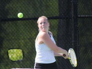 Naugatuck's Sarah Cook lines up a backhand shot May 29 during the Naugatuck Valley League girls team tennis tournament final versus Woodland in Beacon Falls. Woodland edged out the Greyhounds, 4-3, for the title. –ELIO GUGLIOTTI