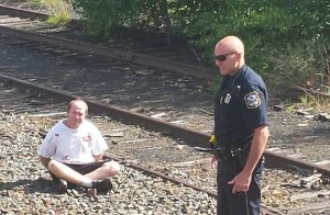 Christopher Norton of Naugatuck is handcuffed at the Waterbury train station after police said he allegedly pushed his girlfriend onto train tracks Thursday. –RA ARCHIVE