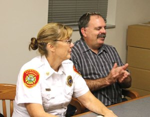Former Naugatuck Fire Chief Ken Hanks, right, applauds after Deputy Chief Ellen Murray, left, was named interim fire chief by the Board of Fire Commissioners last year. The commission will discuss and possibly vote on whether to hire interim Chief Ellen Murray to the chief's position full time Wednesday night. –FILE PHOTO