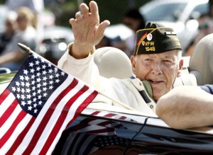 Naugatuck Burgess Robert Burns, a World War II and Korean War veteran, waves to the crowd during the annual Naugatuck Memorial Day Parade in 2014. –RA ARCHIVE