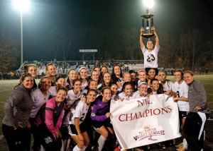 The Hawks celebrate their NVL soccer championship following their 2-1 overtime win over Watertown in the tournament final Nov. 4 at Municipal Stadium in Waterbury. -REPUBLICAN-AMERICAN
