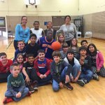 Former NBA player Joe Odhiambo, who played for the Phoenix Suns of the NBA and the Harlem Globetrotters, poses with students and faculty from Western Elementary School in Naugatuck Nov. 9. Odhiambo was at the school as part of an assembly offered by The Bureau of Lectures & Concert Artists, Inc. Odhiambo talked to the students about having faith in themselves, working hard, persistence, patience and responsibility. –CONTRIBUTED