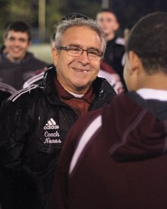 Former Naugatuck High School boys soccer coach Art Nunes is all smiles after the team won the NVL title in 2014.  –FILE PHOTO