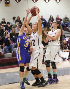 Naugatuck's Michelle Cordova (12) is fouled by Seymour's Nicole Augustitus (3) as she goes up for a shot Jan. 13 in Naugatuck. Seymour won the game, 45-41. –ELIO GUGLIOTTI