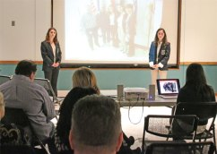 "Naugatuck High School DECA officers Amanda Rinaldi, left, and Alanna Readel present information on the issue of veteran homelessness to an audience at the Whittemore Library in Naugatuck Jan. 27. The presentation was part of a public relations project Rinaldi and Readel are working on for the state DECA competition. Rinaldi and Readel are also selling ""House A Vet"" bracelets in conjunction with the Naugatuck Exchange Club. The bracelets are $5 each and all proceeds are going to a program dedicated to housing homeless veterans. To help veterans with a donation or for more information, contact DECA advisor Tim Reilly at reillyt@naugy.net or (203) 232-0725. –LUKE MARSHALL"