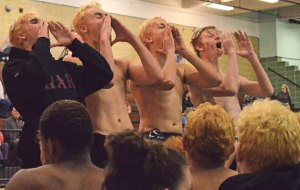 Naugatuck boys swimming captains, from left, Nick Fox, Nick Ryan, Martin Lippai and Colby Storm, lead a chant to inspire the team following a meet versus Holy Cross Jan. 29 at Kennedy High in Waterbury. –KEN MORSE